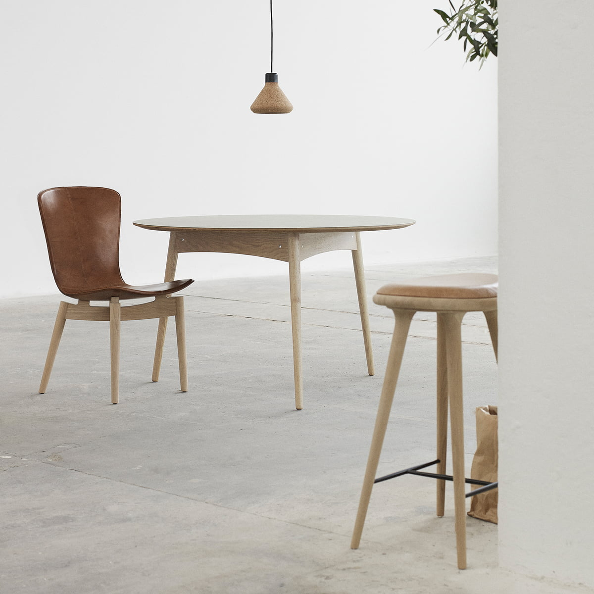 The bar stool by mater made from soaped oak with the luiz pendant lamp made of