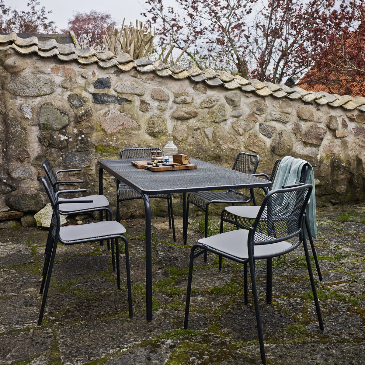 Mira Dining Table And Chairs In The Garden