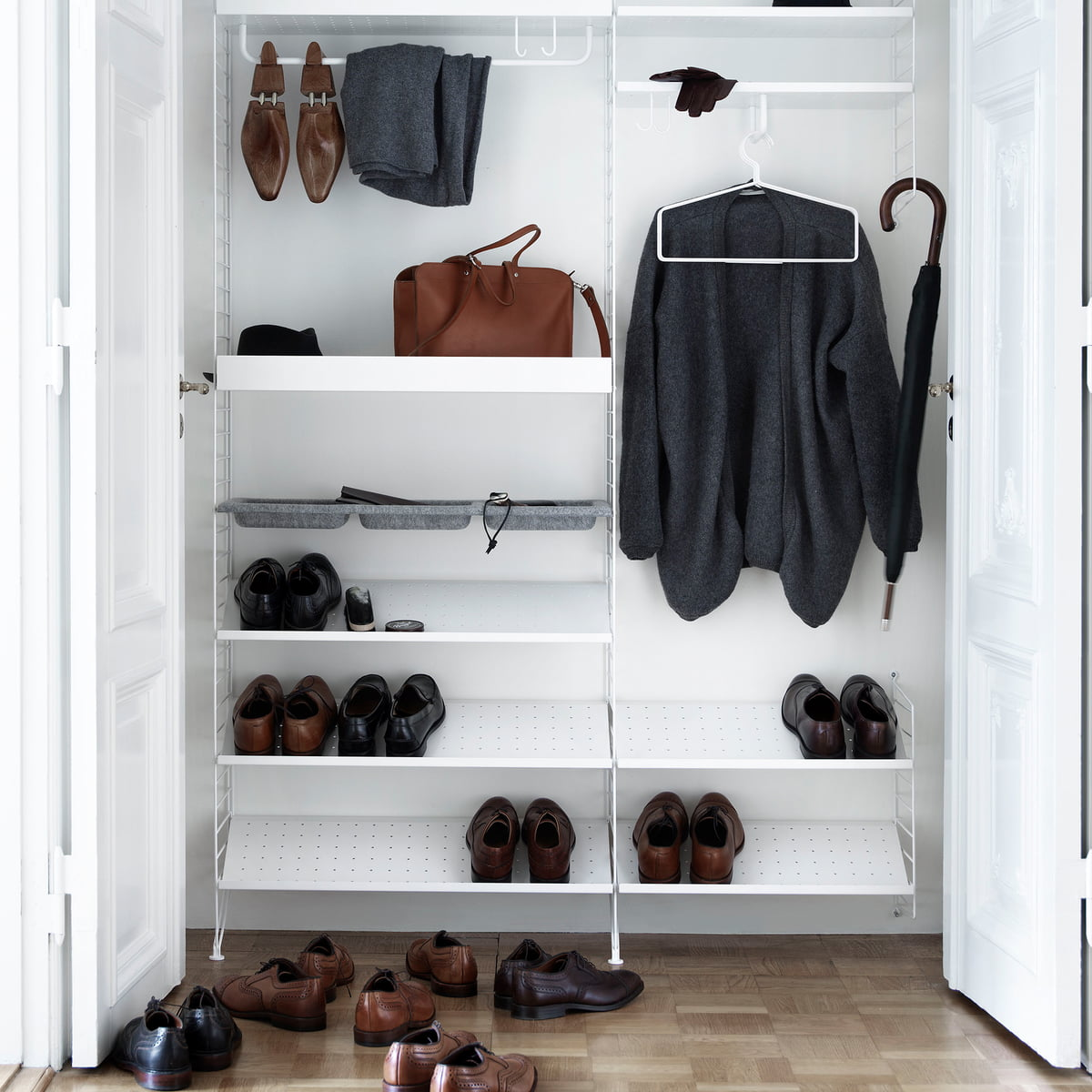 The String System As A Wall Shoe And Coat Cabinet