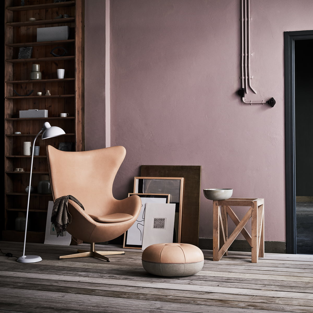 The Fritz Hansen Egg Chair With KAISER Idell   Floor Lamp And Cecilie Pouf  Stylishly Arranged