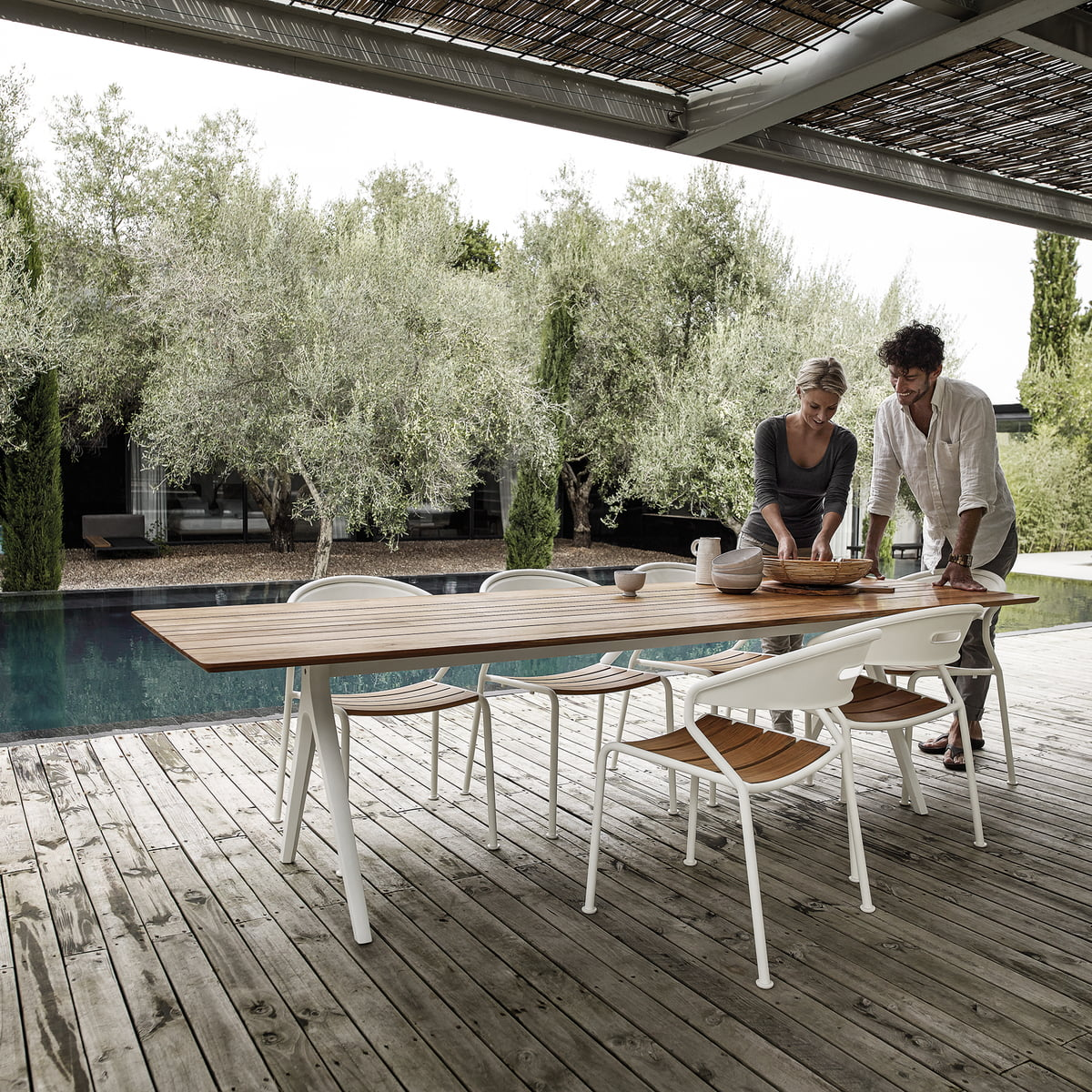 The Gloster   Curve Chair With Matching Table On The Terrace