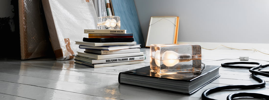 Buy products by Design House Stockholm in the online shop, e. g. the Block Lamp which is composed of a glass block. It looks like the bulb is frozen in ice.