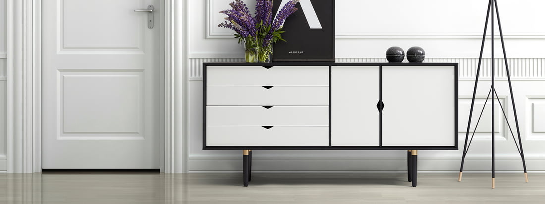 Andersen Furniture is a danish furniture manufacturer. The S6 Sideboard is made of a black oak frame and white doors and drawers - an elegant contrast.