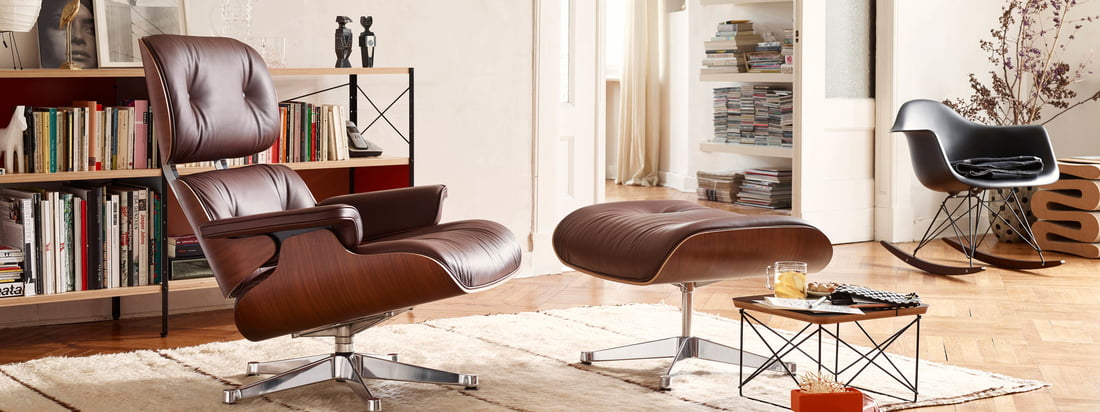 Lifestyle product image: The Lounge Chair by Vitra out of leather was coined by Charles and Ray Eames. The two designers designed the comfortable leather chair for a friend.