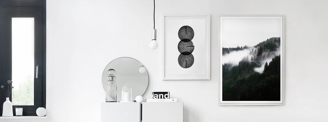 The black and white posters, Winter Wonderland and Circles by artvoll, as a picture gallery in the apartment of interior blogger Alexander Pahr.