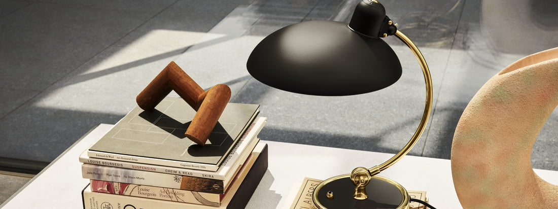 The shade as well as the base of the KAISER idell luxury luminaire have a matt lacquered surface. The details are made of untreated brass and will acquire a natural patina over time.