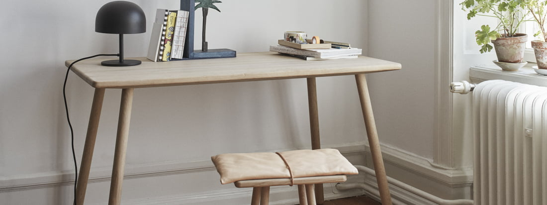 The Georg desk (four legs) by Skagerak in oak in the ambience view. Compact and simply designed, the table fits perfectly into any ambience.