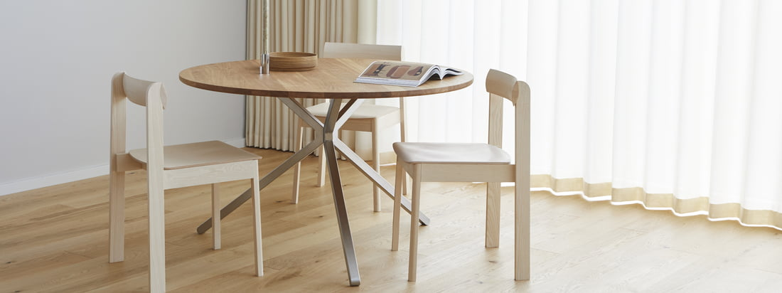The Frisbee table from Form & Refine is the timeless focal point of the living and dining room, and can be complemented with minimalist chairs such as the Blueprint chair.