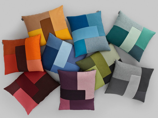 Britt Bonnesen made the Brick cushion for Normann Copenhagen. The brick cushion combines fabrics in different structures and nuances and brings happy accents in the interior.