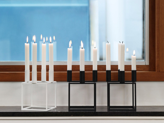 The Kubus 4 candleholder from by Lassen was designed in 1962 by Danish designer Mogens Lassen and has attained the status of a modern design icon.