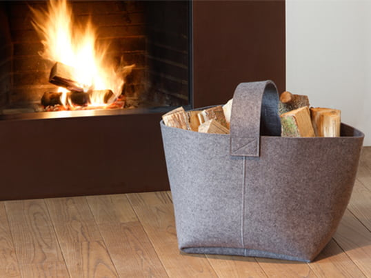 The log basket by Hey Sign is an innovative felt basket. It is square in shape and has a handle at the top, which makes it easy to carry around.