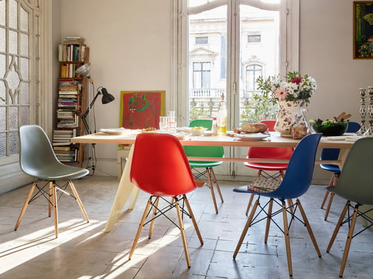 The Plastic Side Chair DSW by Charles   Ray Eames now convinces in basic  dark. Vitra Eames Plastic Chairs in the shop