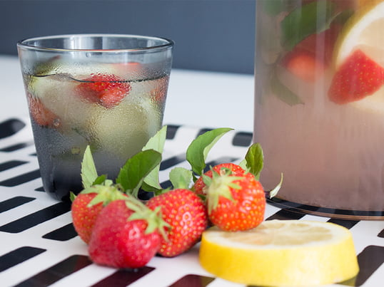 Fruity-refreshing water in Kartio drinking glasses by iittala. Prepared in the Stelton water filter carafe, served on the Siena tray by Artek.