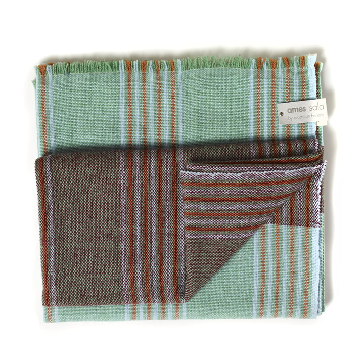 Mulera blanket in green with red accents