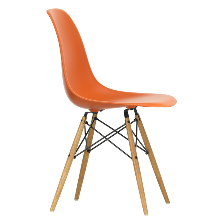 Eames Plastic Side Chair DSW by Vitra in maple yellowish / rust-orange