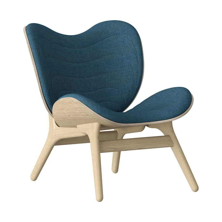 A Conversation Piece Armchair from Umage in natural oak / petrol blue