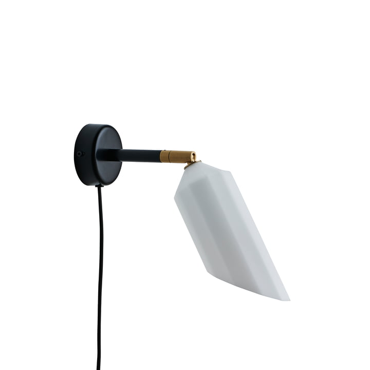 The Pliverré wall light from Le Klint in black / white