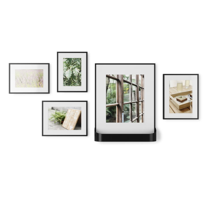 The Matinee picture frame set from Umbra , 5 frames in 3 sizes, 1 with shelf, black