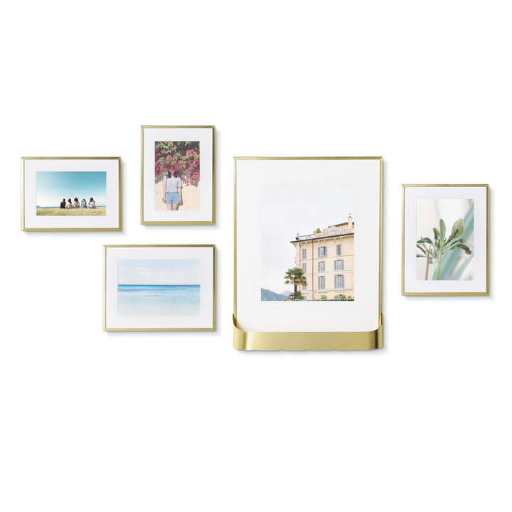 The Matinee picture frame set from Umbra , 5 frames in 3 sizes, 1 with shelf, brass