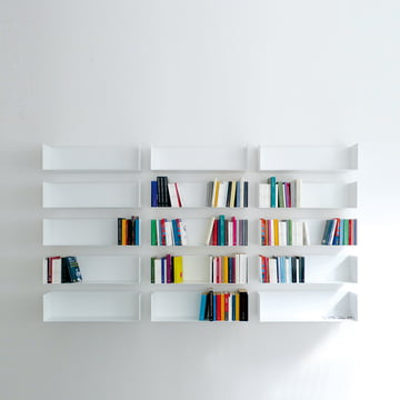 Wall of books made from linea1 a book and DVD shelfs