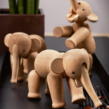 A herd of wooden elephants
