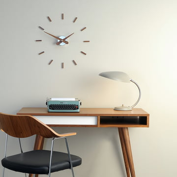 Sunset wall clock by nomon with 12 hour signs of walnut wood