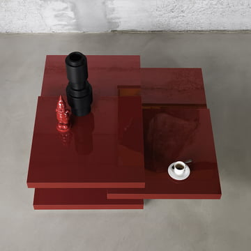 A red coffee table with rotating tabletops