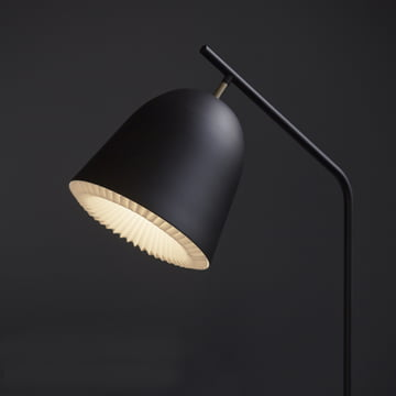 Table lamp with a black outer shell