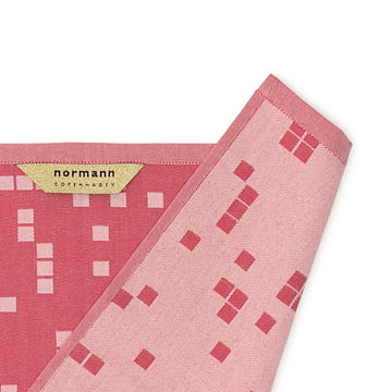 Grids, pixel, circles, rectangles and diamonds decorate the tea towels