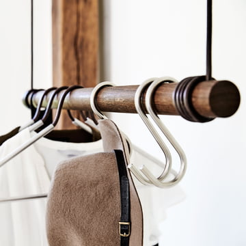 Oblique view of a hanging coat rack with the coat hook by LindDNA