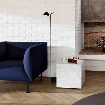 Blue Godot armchair against a white wall