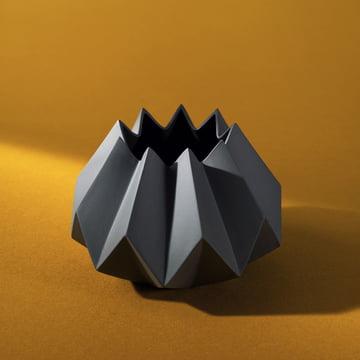 Black folded vase with orange background