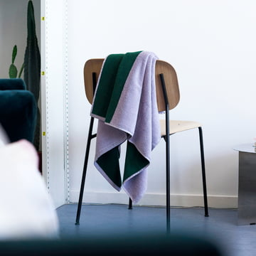 Compose bath towels by Hay on a Chair