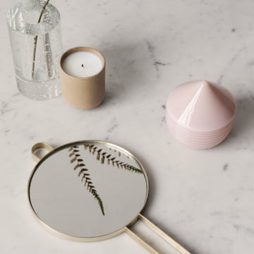 The ferm living - Sekki soy scented candles along with other decorative items.