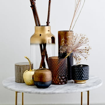 The Tea Light Holder, Vase, Decorative Cherry and Storage Jar by Bloomingville on a Side Table