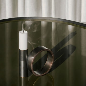 The Balance candleholder by Menu in burnished brass.