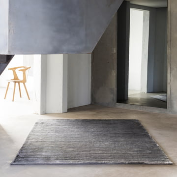 The Massimo - Earth Bamboo Rug Decoratively Placed in a Room