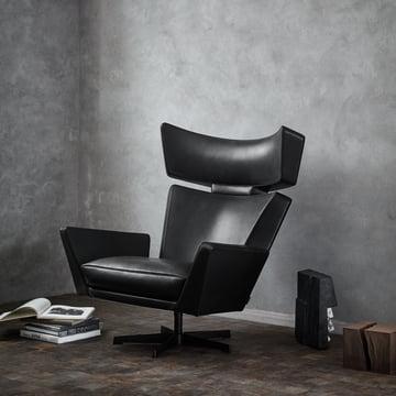 Fritz Hansen - Oksen Armchair in Front of a Concrete Wall