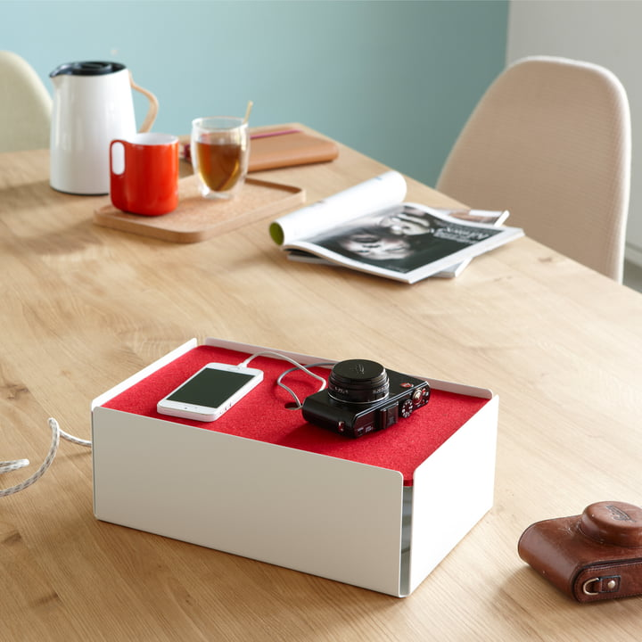 The white-red Charge Box by Konstantin Slawinski keeps chargers invisible
