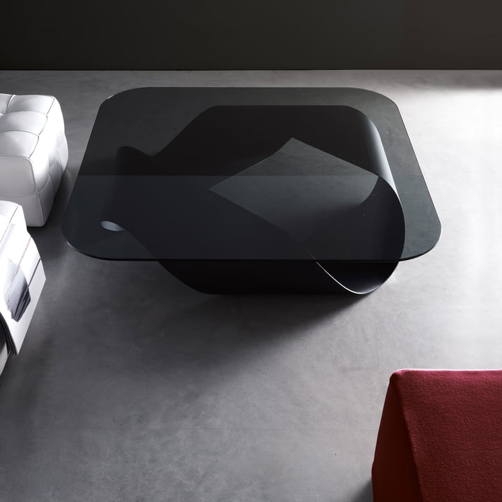 The sculptural Möbius coffee table in black with smoke glass plate