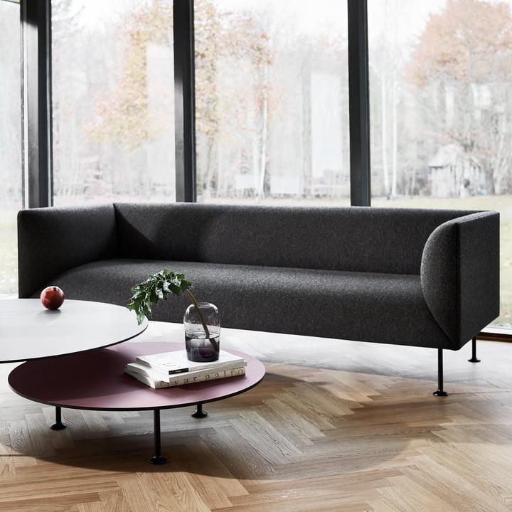 The Godot sofa in front of a window
