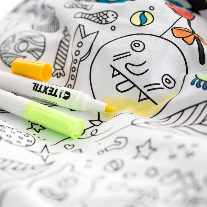 Beanbag with fabric pens to be colored.