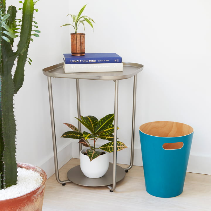 The Umbra - Woodrow Waste Paper Bin in Blue Next to a Side Table