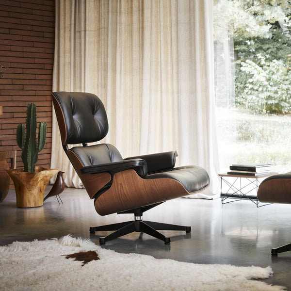 The Lounge Chair with Ottoman from Vitra combines elegance with seating comfort